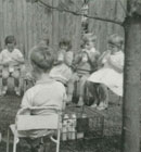 """A group of the children at Hillmorton kindergarten enjoy their morning milk and apple in 1962. """"Those crates were heavy!"""" remembers former CWFKA President Sandy Bain of having to lug the milk up from the kindergarten gate each day."""