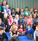 The Kidsfirst Wigram team and children pose for a photo.